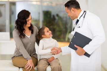 pediatric doctor handshaking with little patient