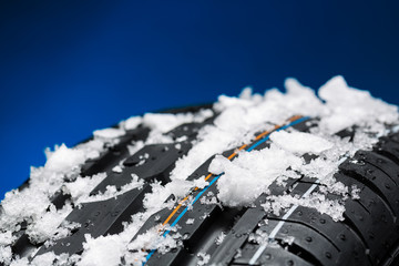 car tire with snow in winter