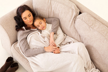 mother and her little girl sleeping