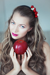 Young beautiful woman with apple in hands