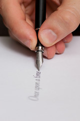 "Fountain pen writing the words ""Once upon a time"""