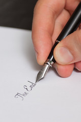 "Fountain pen writing the words ""The End"""