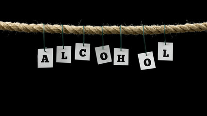 Tags with black letters forming the word alcohol