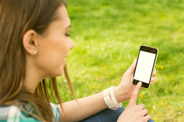 Teenage girl with smart phone outdoors. Mockup.