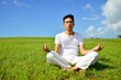 portrait of healthy young man doing yoga