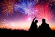 happy family sitting on floor and watching the fireworks - 69699949
