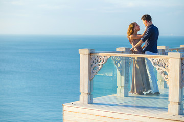 Couple posing on a balcony