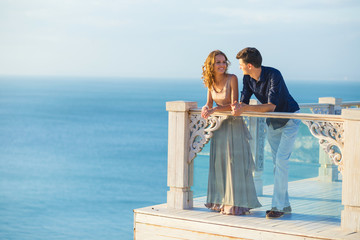 Couple posing on a balcony