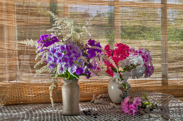 two violet and pink phlox bouquets