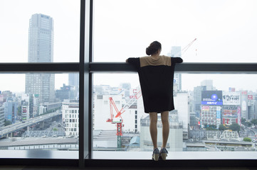 Glass building、Rear View of Women