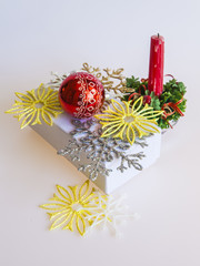 New Year's gift in a white cardboard box, jewelry for a fir-tree