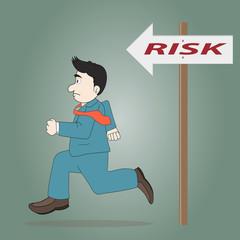 Businessman running  toward risk sign