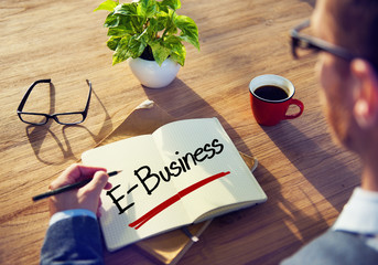 Businessman Writing the Word E-Business