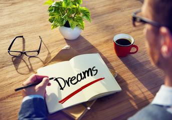 A Businessman Brainstorming About Dreams