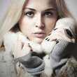 beautiful woman in fur.winter style.blond Girl in Fur Coat