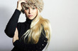 Beautiful Young Woman in Fur Hat.Blond Girl. Winter Fashion