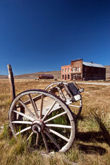 Abandoned wagon and buildings, Bodie Ghost Town, California