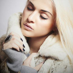 young beautiful woman in fur.winter style.blond Girl in Fur Coat