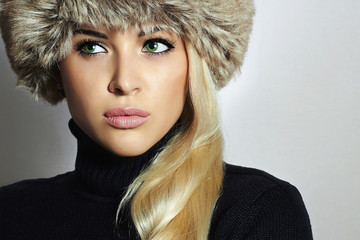 Young Woman in Fur Hat.Beautiful Blond Girl.Winter Fashion