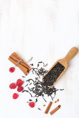 Dried tea leaves, cinnamon and raspberries