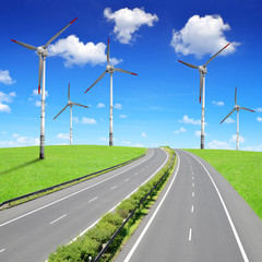 Empty Highway with wind turbines