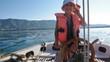 Cute little boy at sail boat wheel