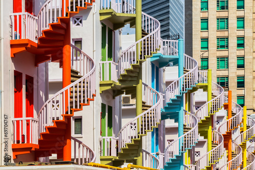 Colorful spiral stairs of Singapore's Bugis Village Poster