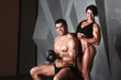 ������, ������: Couple of well trained bodybuilder with dumbbells