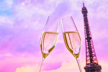 champagne flutes on sunset blur tower Eiffel background