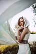 female model in long beige dress posing