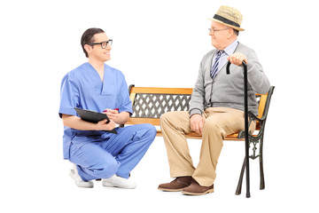 Young doctor talking to a senior gentleman