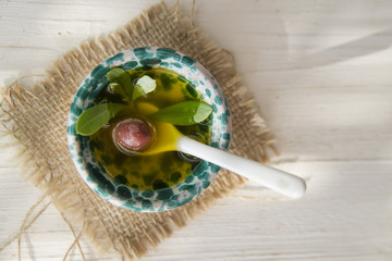Small container with extra virgin olive oil