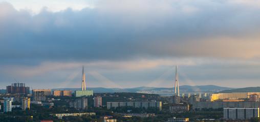Vladivostok, bridge. Sunset. Cloudy sky.