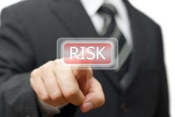 Businessman pressing  risk icon on virtual screen