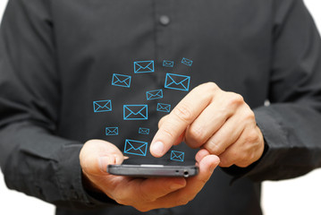 Young man using smart phone with email icons around