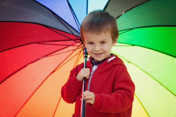 Cute boy with colorful umbrella
