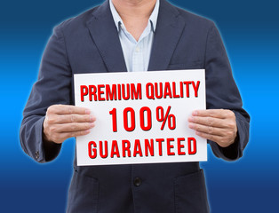 Business man holding premium  quality banner