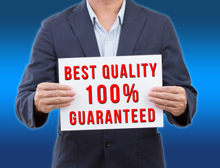 Business man holding best quality banner