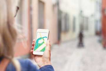 Tourist using navigation app on the mobile phone