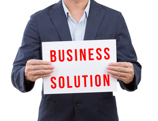 Businessman holding business solution banner isolated on white b