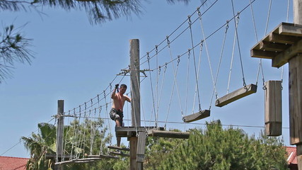 Adventure park, the young man performs.