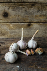 Still life with garlic on the old wooden background
