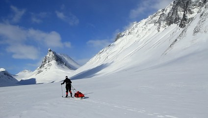 Cross country skier with pulka (sled) in Swedish Lapland.