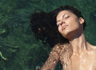 beautiful woman who is relaxing in the water