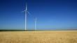 Two wind turbines generating sustainable energy.