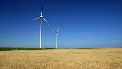 Two wind turbines generating sustainable energy.