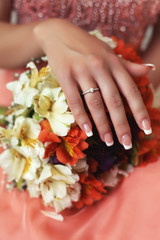 beautiful hand of bride with wedding ring