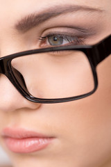 Beautiful young woman wearing glasses close-up.
