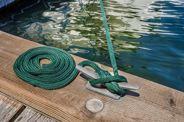 Nautical Mooring Rope tied to a Cleat with a Knot