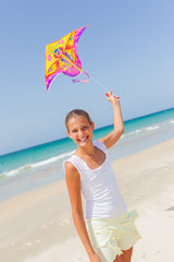 Child flying kite beach outdoor.